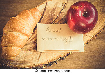 Apple, Croissant and Good Morning Note on Rustic Wooden ...