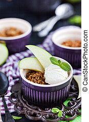 Apple crumble dessert with vanilla ice cream