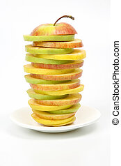 Apple cut into pieces on a white plate