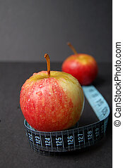 Apple Dieting - This is an image of a two apples and a...