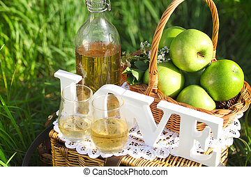 Apple drink outdoors - Apple drink and basket with green ...