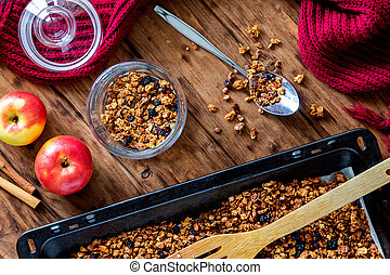 Apple granola with spices on a wooden table