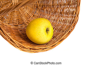 apple in a wicker basket on a white background.