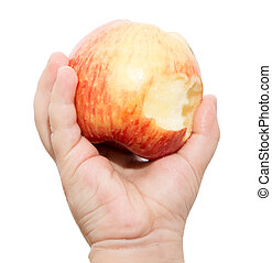 apple in the children's hand on a white background