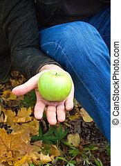 apple in the hands of men