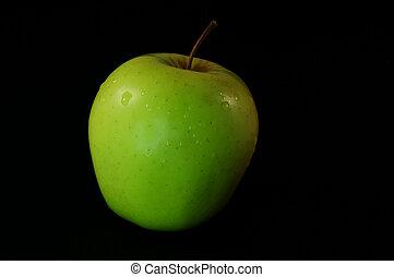 apple isolated on black background