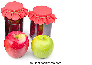 Apple jam in a glass jar, fresh red and green apples isolated on white background. Free space for text.