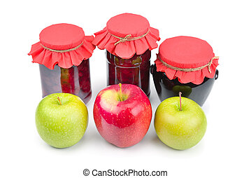 Apple jam in a glass jar, fresh red and green apples isolated on white background.