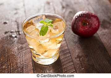 apple juice and apples on wooden table