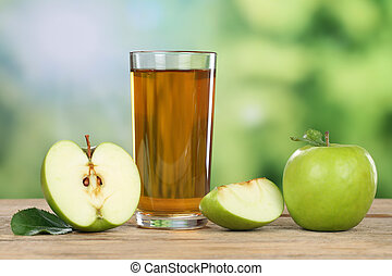 Apple juice and green apples in summer