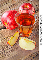 Apple juice. Fresh ripe apples and glass of juice