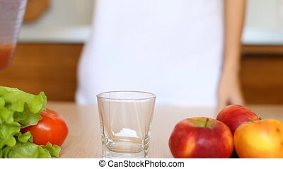 apple juice grape juice, white wine, beer is poured into a glass.
