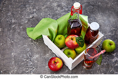 Apple juice in glass bottle and cup