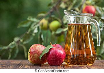 apple juice in glass jug