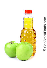 Apple juice in plastic bottle and two apples on a white