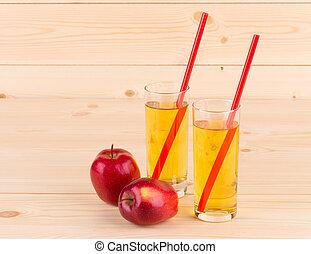 Apple juice on wooden table.