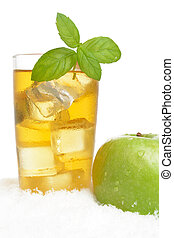 Apple juice,ice cubes with mint on white on snow