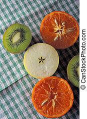 Apple, kiwi and tangerines