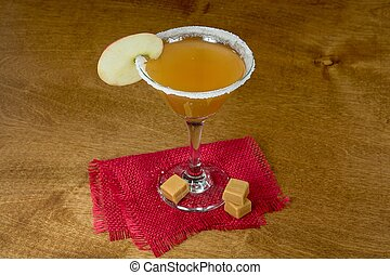 apple martini with caramel candy