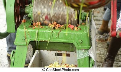 Apple mill crushing apples