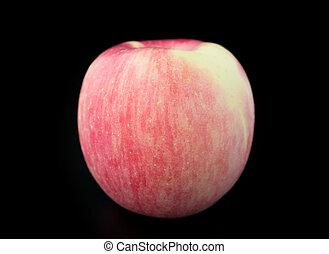 apple on a black background