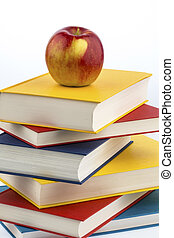 apple on a stack of books - an apple lies on a stack of ...