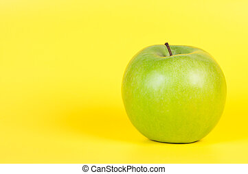 Apple on a yellow background.