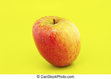 apple on a yellow background
