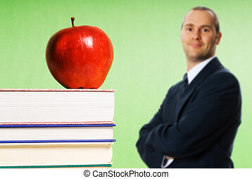 Apple on books - apple sitting on top of books in a...