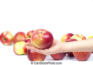 Apple on palm