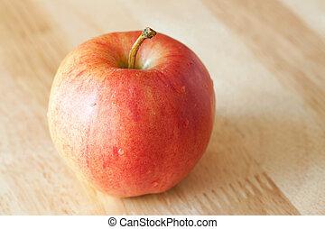 Apple on rustic wood background