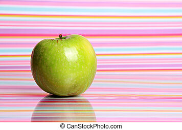 apple on stripy background