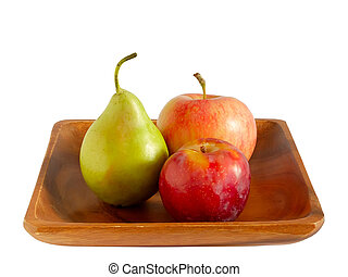 Apple, pear and plum on a wooden plate