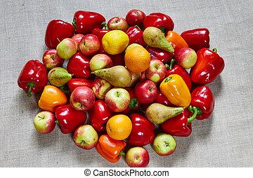 Apple, pear, various paprika, orange on a gray canvas