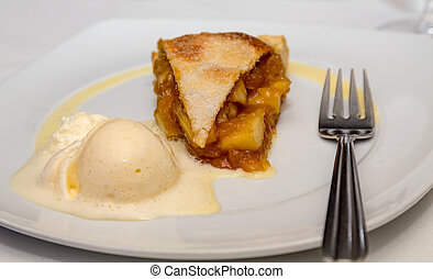 Apple Pie A la Mode with fork on plate