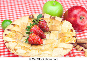 apple pie, apple, lime, cinnamon and strawberry on plaid fabric