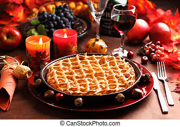 Apple pie for Thanksgiving with wine and grapes