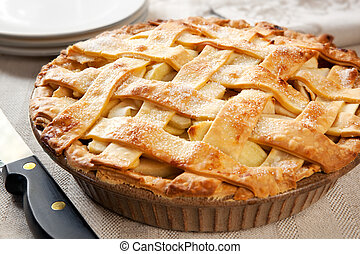 Apple Pie - Home-baked lattice apple pie, in a brown ceramic...