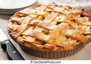 Apple Pie - Home-baked lattice apple pie, in a brown ceramic...