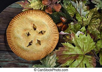 apple pie in fall leaves