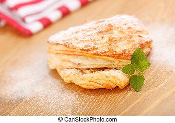 Apple pie on wooden board