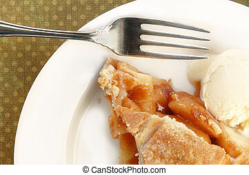 Apple Pie - Slice of apple pie with ice cream and fork.