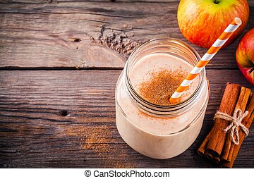 Apple pie smoothie with cinnamon in a glass mason jar