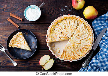 Apple pie, tart on a wooden background. Top view.
