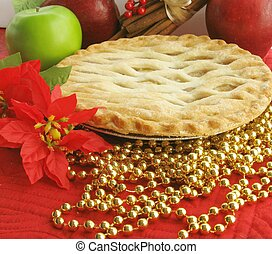 Apple pie with apple in background