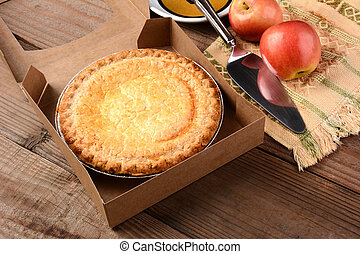 Apple Pie with Fresh Apples on Wood Table