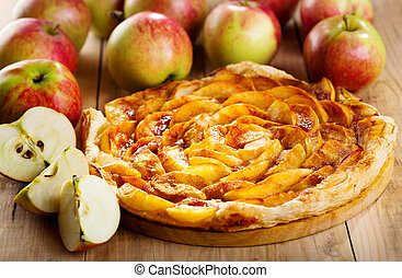 apple pie with fresh fruits on wooden table