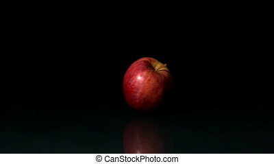 Apple spinning on black background