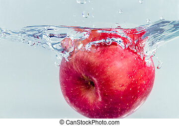 Apple splashing in water