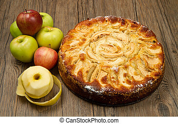 Apple Tart with fresh apple on table